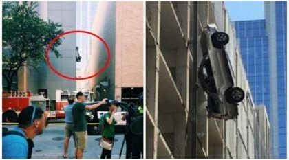 Motorista perde controle e fica com seu SUV pendurado em prédio-garagem